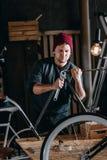 Young handyman repairing bicycle royalty free stock photos