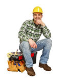 Young handyman sit on toolbox Royalty Free Stock Images