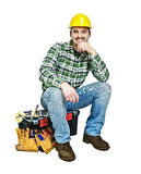 Young handyman sit on toolbox stock photos