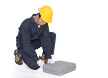 Young handyman sitting with his tool box Royalty Free Stock Images