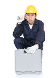 Young handyman sitting with his tool box Stock Photos