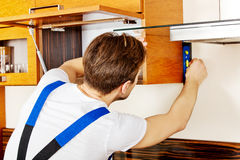 Young handyman with spirit level Royalty Free Stock Images
