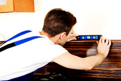 Young handyman with spirit level Stock Photography