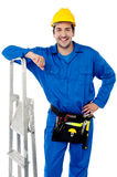 Young handyman with step-ladder Royalty Free Stock Photos