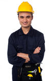 Young handyman with a tool belt Stock Images