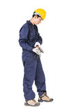 Young handyman in uniform hold grinder Royalty Free Stock Photography