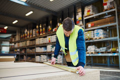 Young handyman working in a warehouse Royalty Free Stock Image