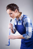 Young handywoman with a jemmy Stock Photography