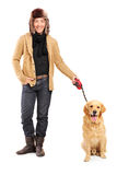Young hansdome guy with dog Stock Photography