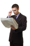 Young hansome man in suit with newspaper. Hold glasses, isolated on white Royalty Free Stock Photo