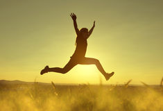 Young happiness woman jumping high Royalty Free Stock Image