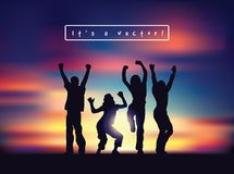 Young happy active people silhouettes and sunset sky. Royalty Free Stock Image