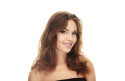 Young happy adorable brunette woman with curls hairstyle smiling posing on white studio background Royalty Free Stock Photo