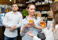 Young happy adults at bar Royalty Free Stock Photos