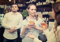 Young happy adults at bar. Casual acquaintance of young happy adults at bar Royalty Free Stock Photography