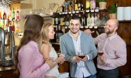 Young happy adults at bar Royalty Free Stock Photos