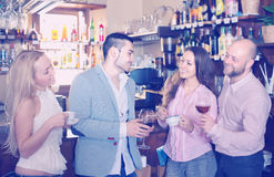 Young happy adults at bar stock photography