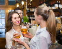Young happy adults at bar Stock Image