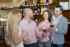 Young happy adults at bar Stock Photos