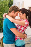 Young happy affectionate couple flirting outdoors Royalty Free Stock Photography