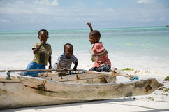 Young happy african boys on fishing boat Royalty Free Stock Image