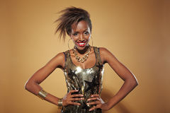 Young happy african woman. Posing with her arms akimbo Stock Photos