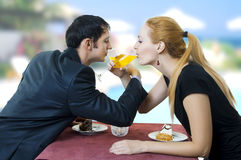 Young happy amorous couple drink with white wine Stock Images
