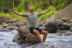 Free Young Happy And Attractive Man With Travel Backpack Hiking In River At Forest Feeling Free Enjoying Nature And Fresh Environment Stock Photos - 166245813