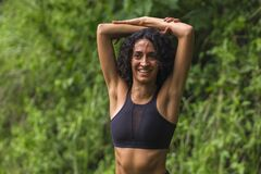 Free Young Happy And Attractive Middle Eastern Woman With Curly Hair And Athletic Body Stretching Arms Outdoors Before Running Workout Royalty Free Stock Photo - 172845175