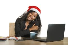 Young Happy And Beautiful Black Afro American Business Woman In Santa Christmas Hat Working At Office Computer Desk Smiling Succes Stock Image