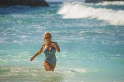 Free Young Happy And Sexy Blond Woman In Swimsuit Bikini Playing With Waves In The Sea At Stunning Beautiful Tropical Beach Enjoying Stock Photography - 151584852
