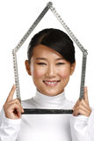 Young happy asian chinese woman make an house symbol Stock Photo