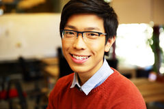 Young happy asian man with glasses Stock Photos