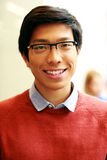 young happy asian man with glasses Royalty Free Stock Photos