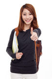Young happy Asian student show thumb. Stock Photo