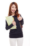 Young happy Asian student show thumb. Royalty Free Stock Photo