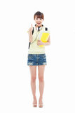 Young happy Asian student show thumb Royalty Free Stock Photos