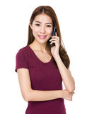 Young happy asian woman is using mobile phone Royalty Free Stock Image