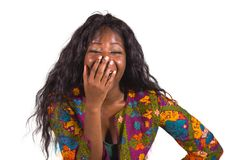 Young happy and attractive black African American woman in colorful stylish shirt acting playful and excited smiling cheerful enjo stock photo