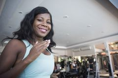 Young happy and attractive black African American woman at gym running on treadmill machine smiling cheerful and sweaty in gym tra Stock Photos