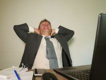 young happy and attractive business man working at office comput stock images