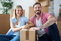Young happy couple celebrating moving to new home royalty free stock images