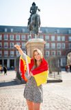 Young happy attractive exchange student girl having fun in town visiting Madrid city showing Spain flag Royalty Free Stock Image