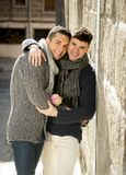 Young happy attractive gay men couple holding rose hugging and kissing outdoors Valentines free homosexual love Royalty Free Stock Photo