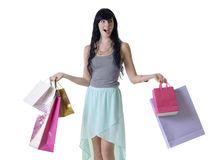Young happy attractive girl carrying shopping bags isolated on white Stock Photo