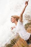 Young happy attractive woman arms wide open Stock Photography