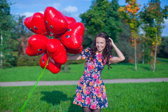 Young happy attractive woman in beautiful dress Stock Photos