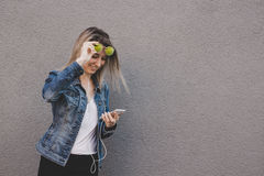 Young happy attractive woman using smart phone. Gray background, copy space Stock Photos