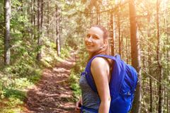 Young happy backpacker woman walking in woods stock photos
