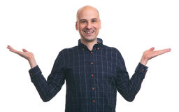 Young happy bald man gesturing with hands Royalty Free Stock Photos